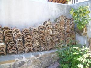 Kokopatria tiles in ch'yard.